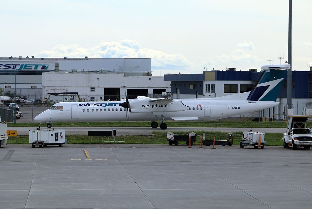 De Havilland Canada DHC 8 400 of WestJet Encore C GWEU at Calgary Airport