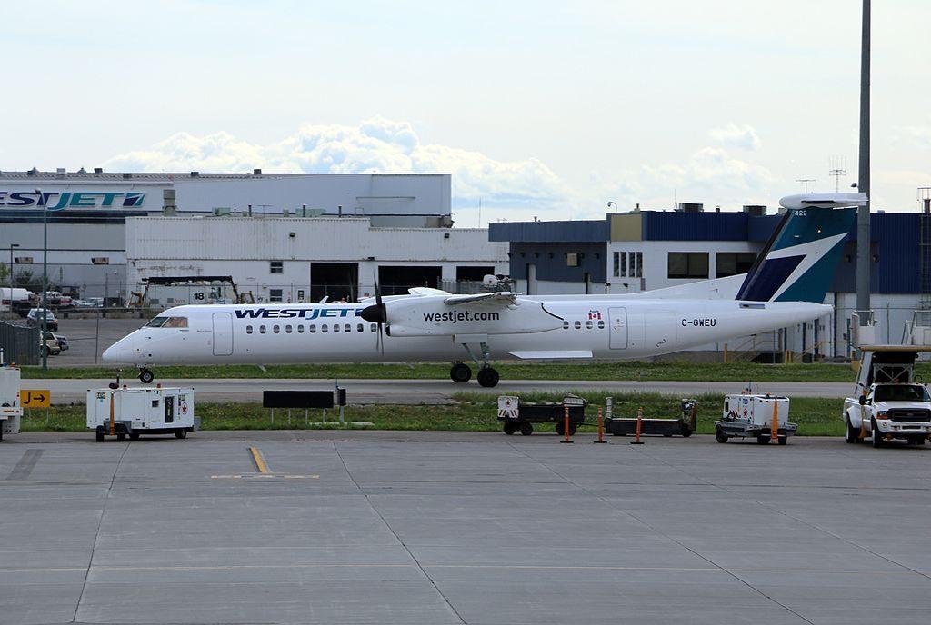 De Havilland Canada DHC 8 400 of WestJet Encore C GWEU at Calgary Airport