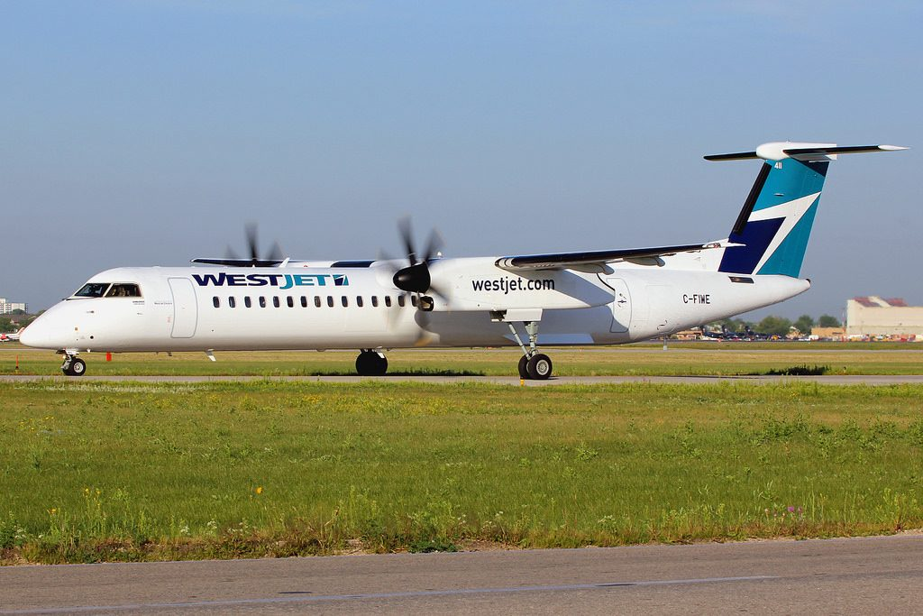 WestJet Encore Bombardier Dash 8 Q400 C FIWE at Winnipeg YWG
