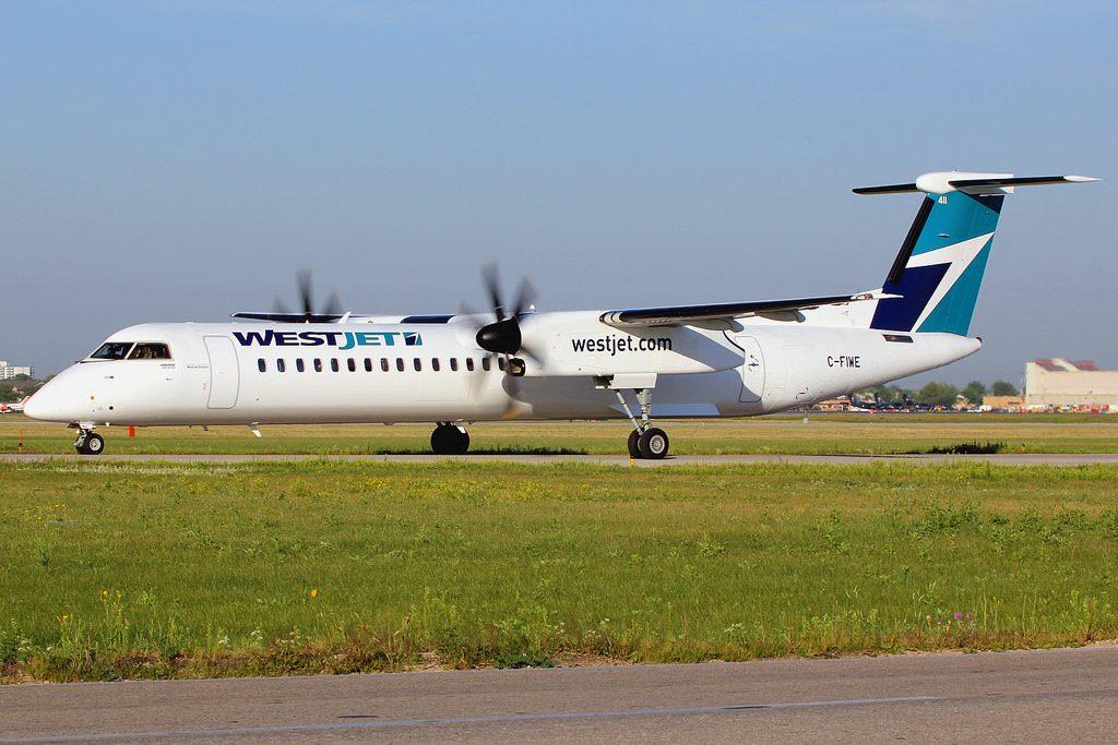WestJet Encore Bombardier Dash 8 Q400 C FIWE at Winnipeg YWG