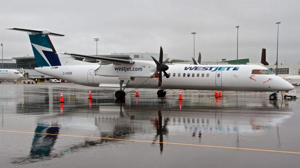 WestJet Encore Bombardier Dash 8 Q400 C GVEN at Vancouver International Airport