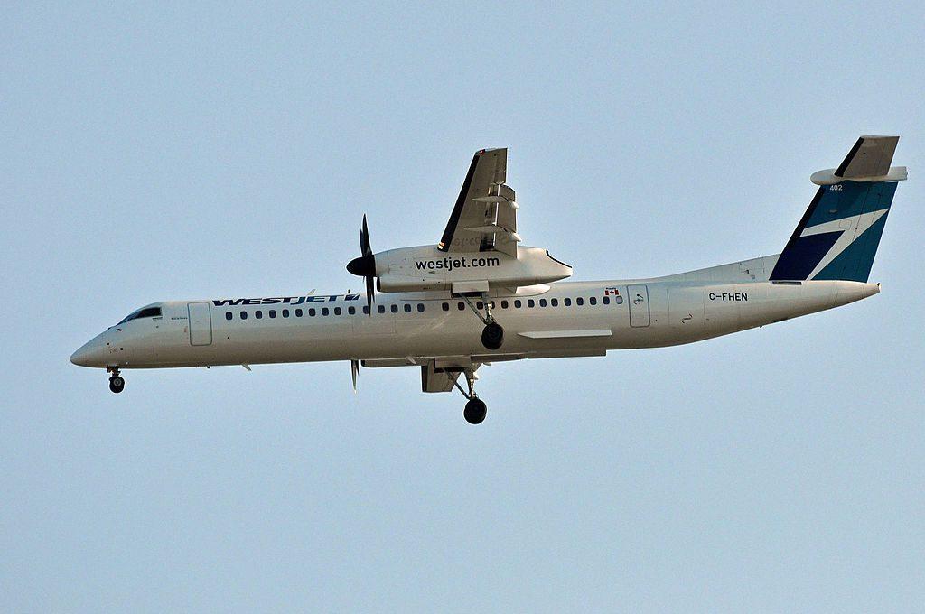 WestJet Encore C FHEN Bombardier Dash 8 Q400 on final approach at Vancouver International Airport