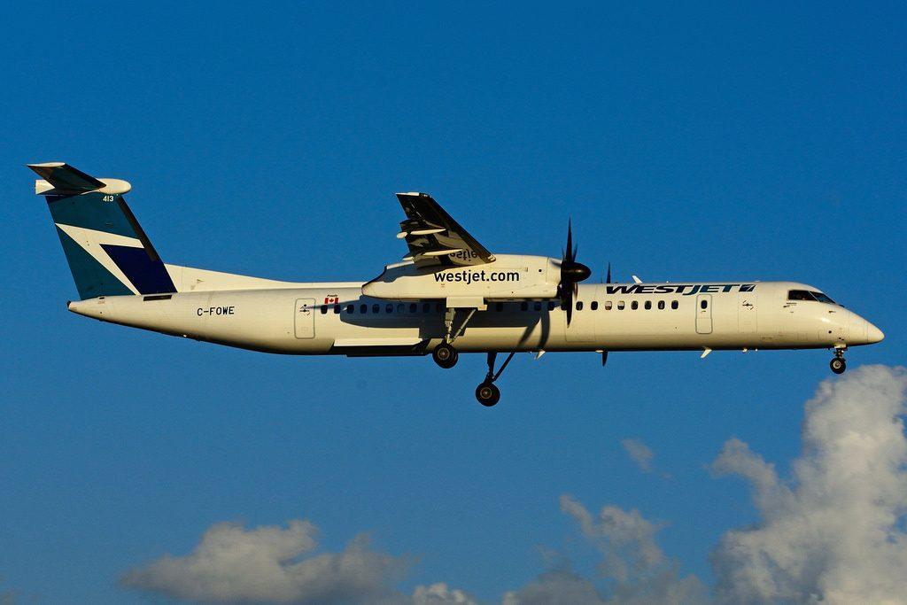 WestJet Encore C FOWE Bombardier Dash 8 Q400 at Toronto Lester B Pearson International Airport Ontario Canada