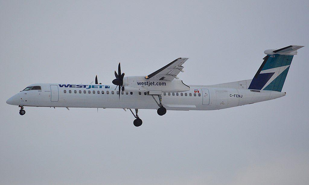 WestJet Encore Dash8 Q400 C FENJ landing on runway 35L at Calgary International Airport