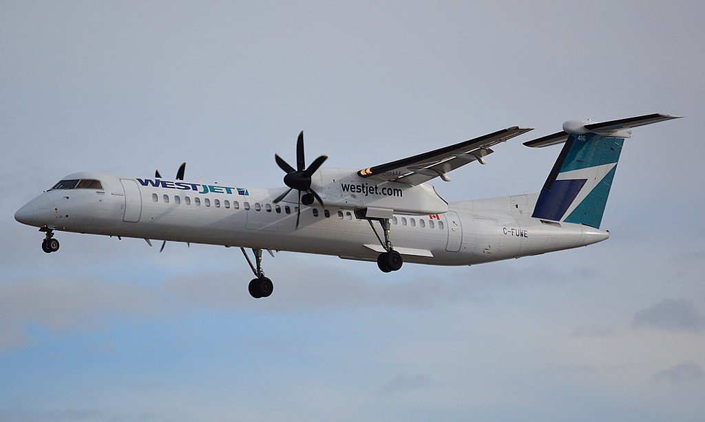 WestJet Encore Dash8 Q400 C FUWE landing on runway 35L at Calgary International Airport