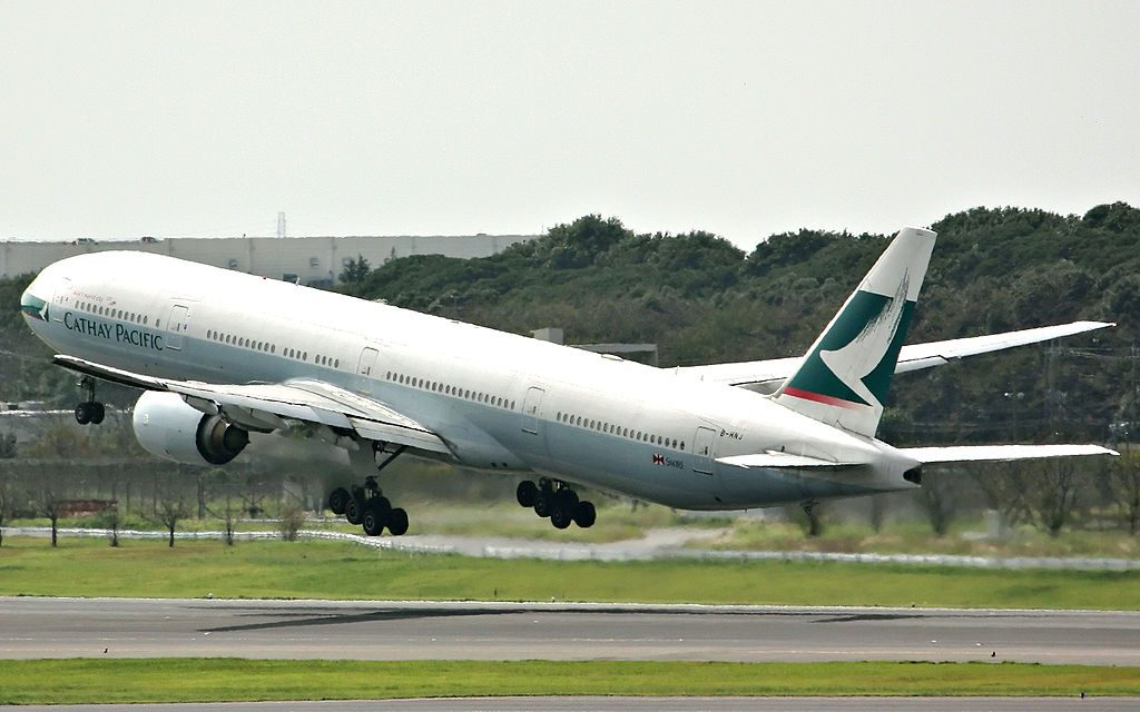 Boeing 777 300 of Cathay Pacific B HNJ landing at Narita International Airport