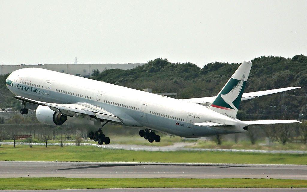 Boeing 777 300 of Cathay Pacific B HNJ landing at Narita International Airport