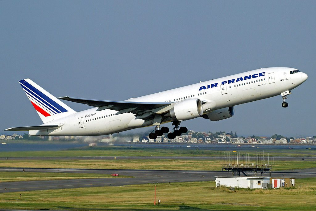 F GSPY Air France Boeing 777 200ER takes off from Logan Airport Boston