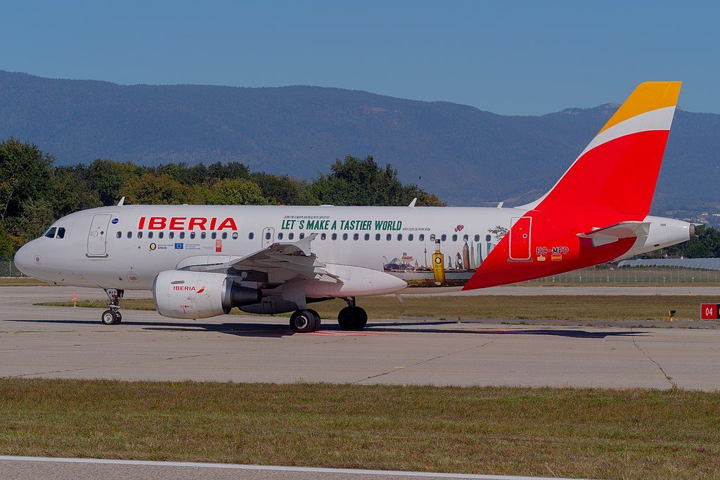 Iberia EC MFP Airbus A319 111 Lets Make Tastier World at Geneva International Airport