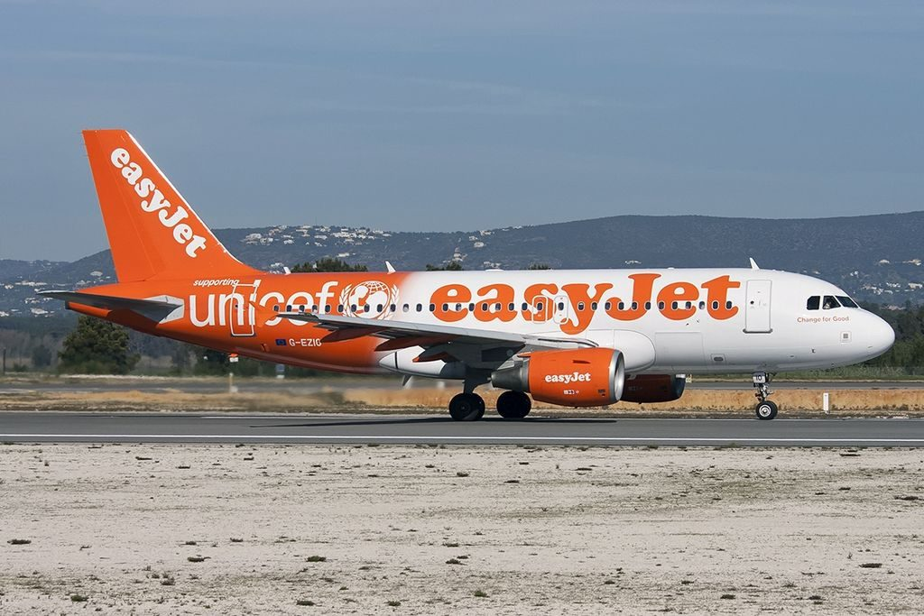 Airbus A319 111 easyJet G EZIO UNICEF Livery at Faro Airport