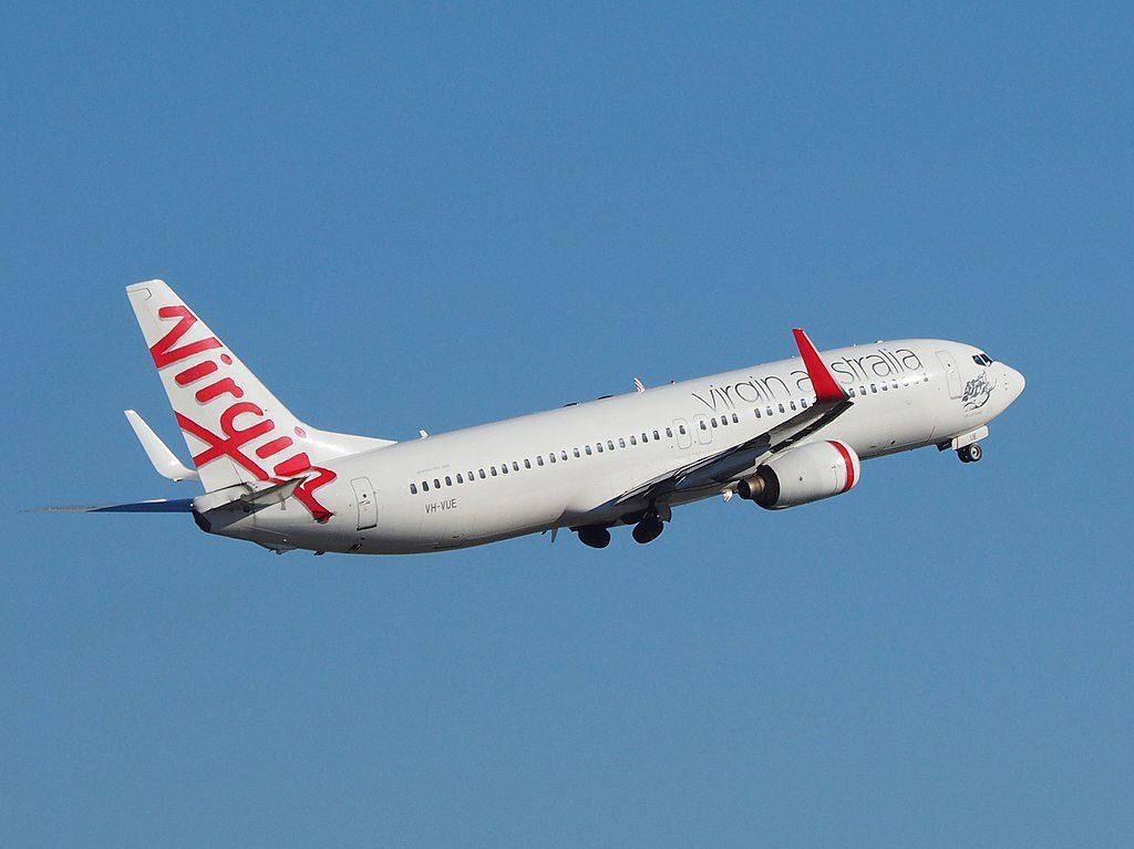 Boeing 737 8FEWL Virgin Australia VH VUE Curl Curl Beach taking off from Sydney Airport