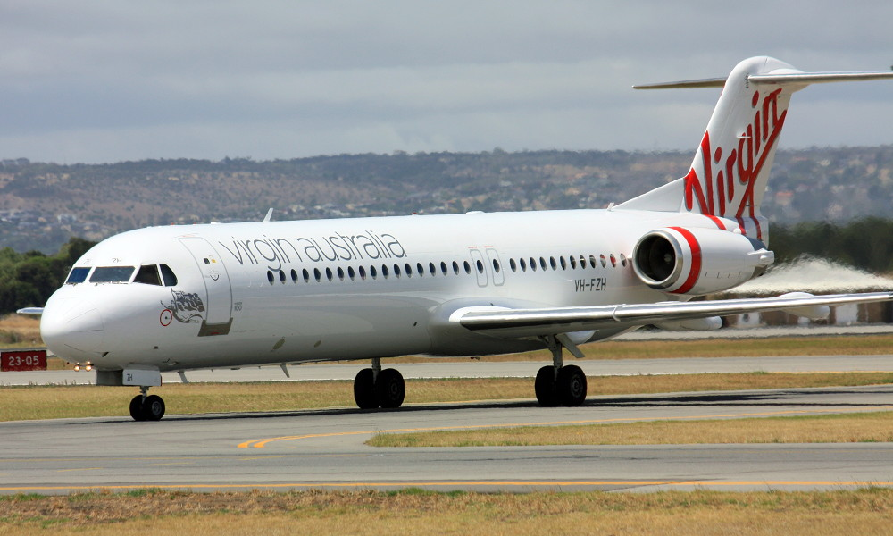VH FZH Virgin Australia Regional Fokker F100 in the standard livery at Adelaide West Beach Airport