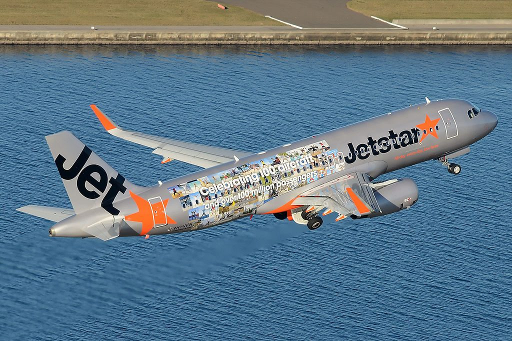 VH VFN Jetstar Airbus A320 232WL 100 million passengers livery climbing out of Sydne