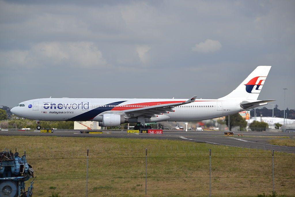 9M MTC Airbus A330 323 of Malaysia Airlines with One World titles departing rwy 16R at Sydney