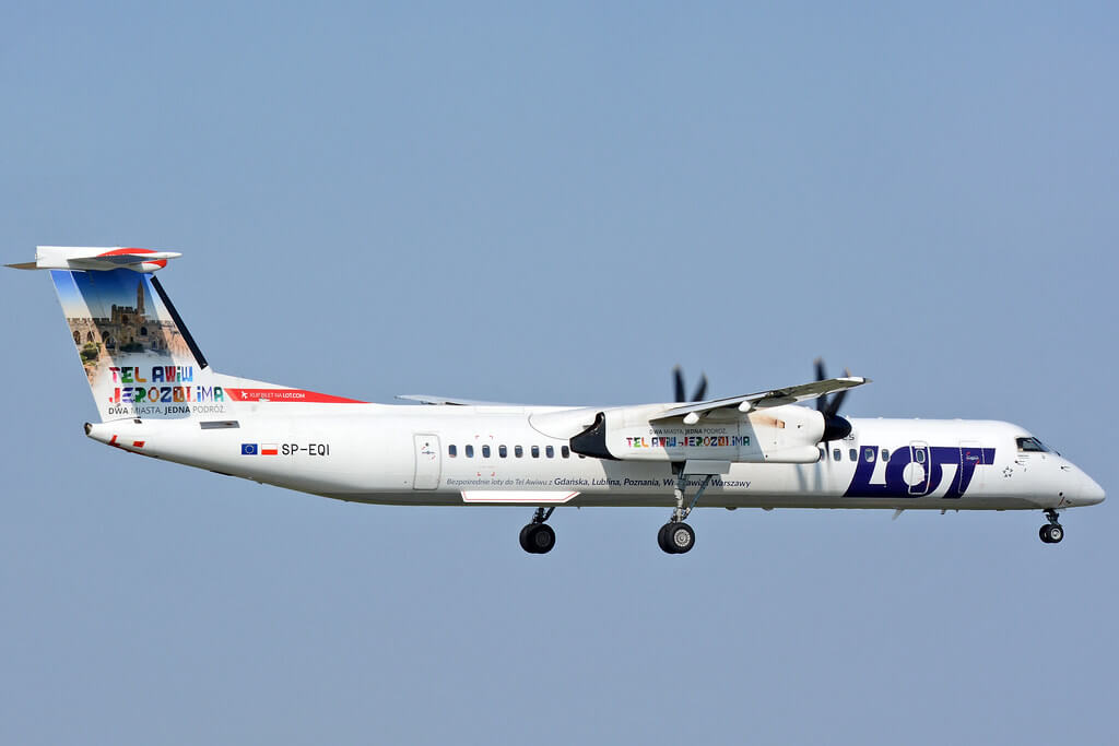 LOT Polish Airlines De Havilland Canada DHC 8 402Q Dash 8 SP EQI special colours which promotes holiday trips to Israel from several cities in Poland at Warsaw Frederic Chopin Airport