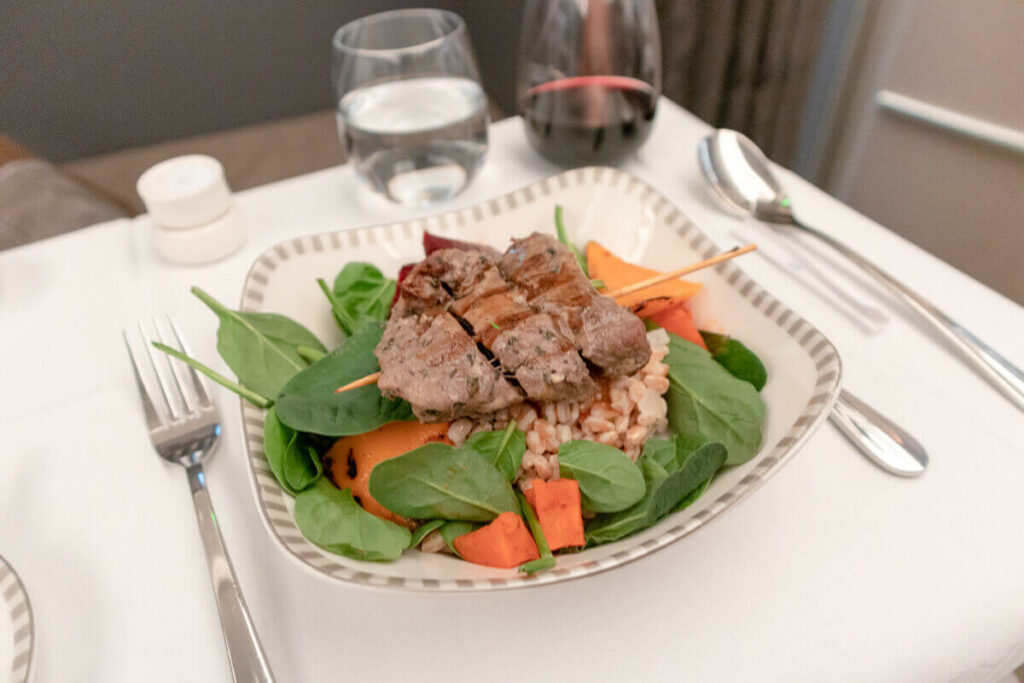 Singapore Airlines Airbus A350 900 Business Class Grilled Lamb Kabab on a Farro Pumpkin Spinach and Beetroot Salad